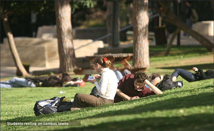 Students resting on campus lawns